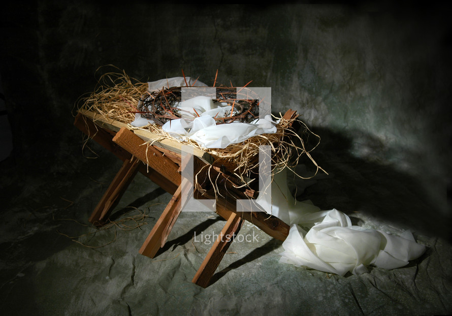 manger with a crown of thorns laying in it