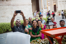 happy family taking a picture together in India