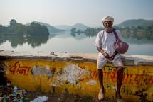 a man sitting on a bridge in India