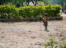 boy playing with a toy car in India