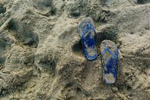 flip flops in the sand on a beach