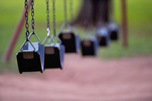 empty swings on a swing set