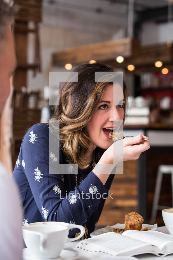 woman eating at a bible Study.