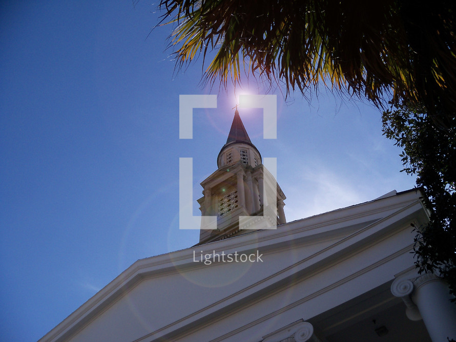The Beacon of Hope - sun above a church steeple