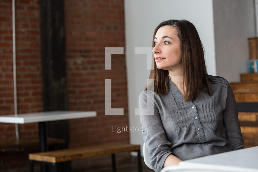 side profile of a woman sitting at a table