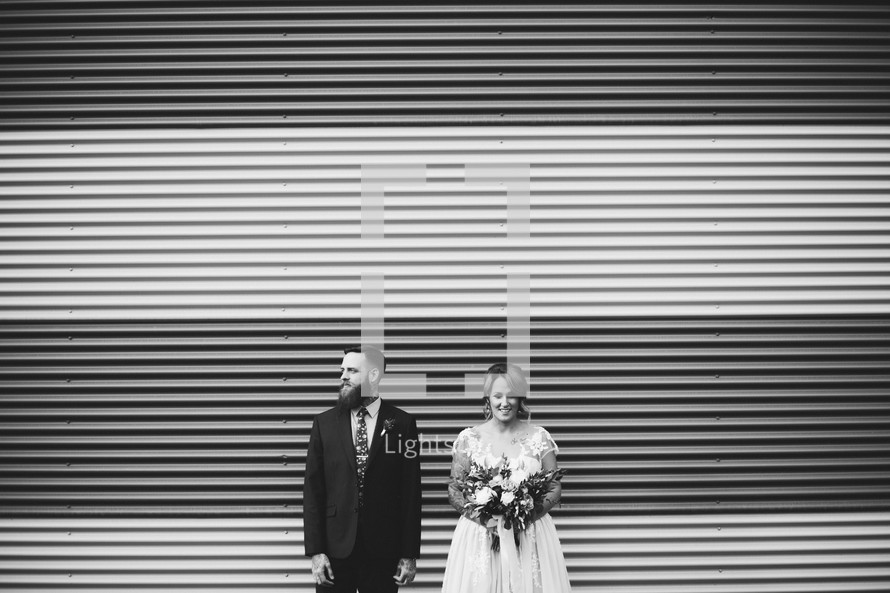 bride and groom standing outdoors