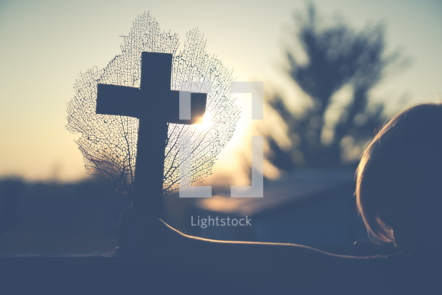 Sunset on Cross that is held up