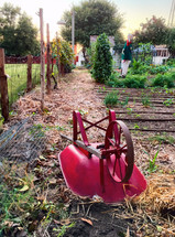 overturned wheelbarrow in a garden