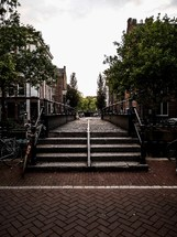 steps and brick pavers sidewalk in Amsterdam, Netherlands