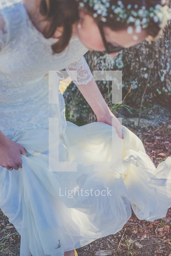 bride lifting the bottom of her dress