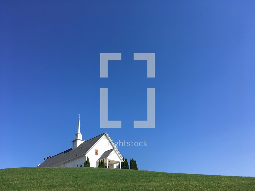 A local country church building on a hillside