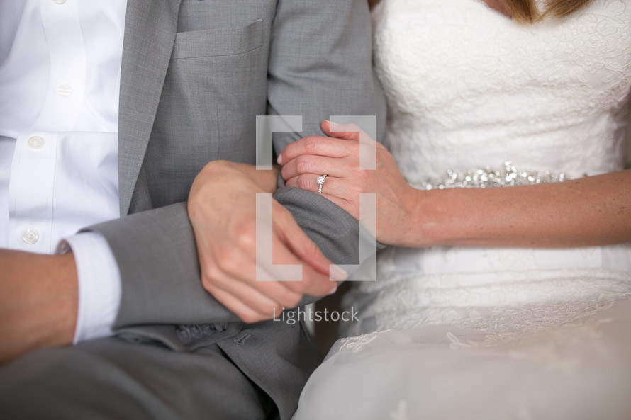 bride and groom arm in arm