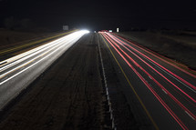 blurred headlights and taillights on a divided highway