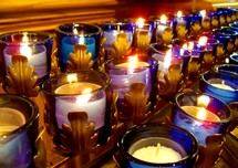 Purple and Blue Candlelight Communion during a Catholic Church service.