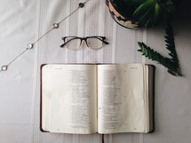 open Bible and reading glasses