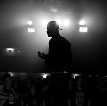 silhouette of a man holding a microphone