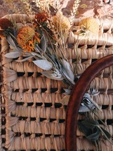 dried flowers on a picnic basket