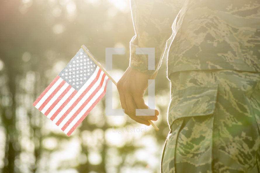 soldier holding an American flag