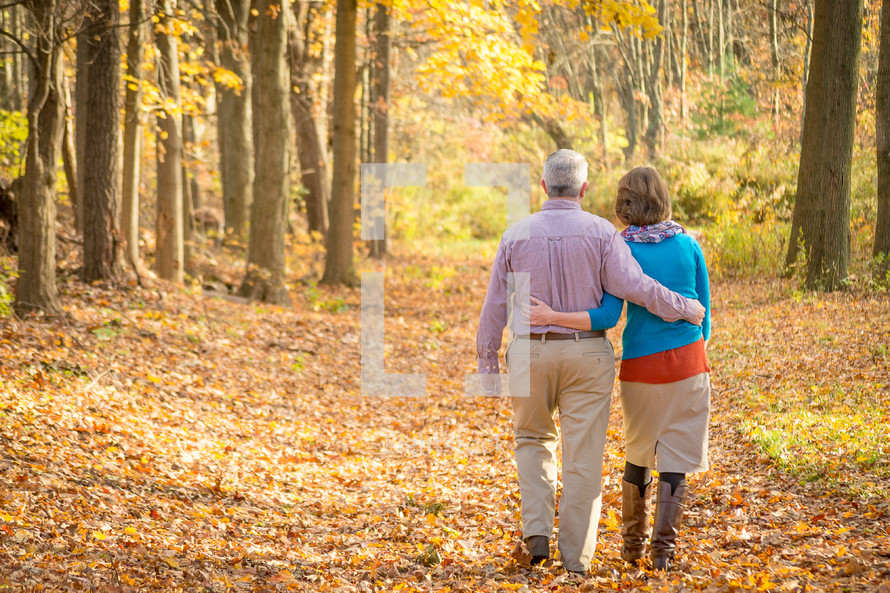 couple walking in an autumn forest