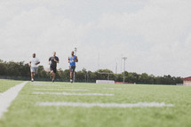 men running at football practice