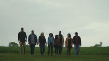 a group walking tougher in a field