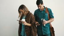 a couple distracted by their cellphones