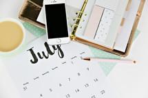 planner, calendar, pencil, and mug