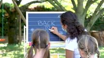 teacher teaching outdoors