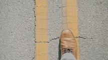 a man walking on a road