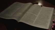 light shining on the pages of a Bible