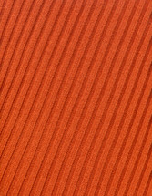 Orange knit sweater background. Red cotton wool textured for a background pattern