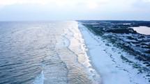aerial view over a white sand beach