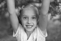 Young girl with raised arms