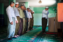 Imam leading Namaz prayers at Mosque with other Muslim Kurdish men