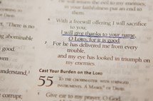 An underlined scripture in the Bible regarding giving thanks.