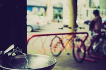 Water fountain by the bike racks.
