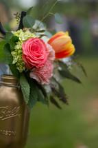 flowers in a gold mason jar