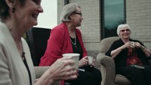 senior women discussing scripture at a Bible study