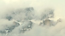 clouds and fog over mountain peaks