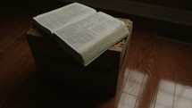 open Bible on a wooden crate