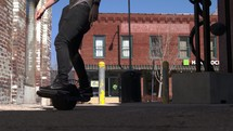 a person riding a one wheel skateboard