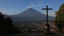 Antigua Volcano Time Lapse with cross in foreground
