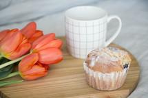 muffin, tulips, and coffee mug