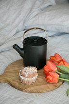 tea pot, muffins, and tulips