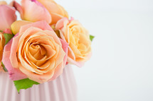 pink and peach roses in a vase