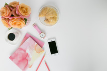 pink and peach roses, notes, watercolor, spring, coffee, watch, croissant, iPhone, pencil, white background