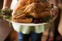 woman holding a Thanksgiving turkey