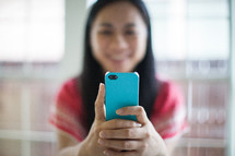 Asian woman checking her cellphone