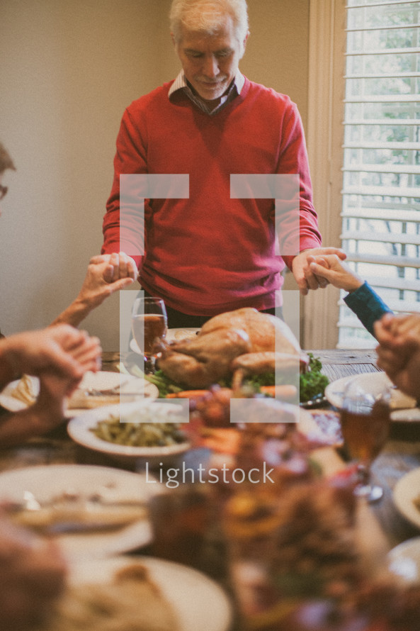 Family prayer over the Thanksgiving meal.