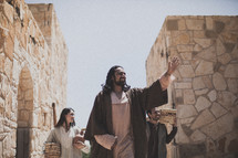 woman at the well - Jesus and his disciple walking through town